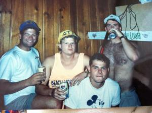 "A typical ""work week"" scene at the Delt house. Mike McDonald (McD), Phil Jackson (Fao), Chris Staniszewski (Dirty Stan) and my Shirtless self enjoy some fine Buckhorn beer with tools nearby."