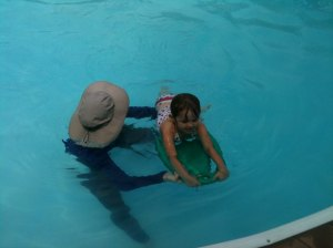 My daughter learning to swim...No helmet or shoulder pads required.