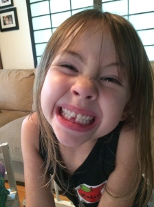 My daughter, proudly showing off where her tooth had been...Quite an ending to her first day of Kindergarten.
